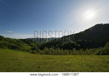 A Rural Landscape Of Green Farm Fields And Country Hillsides