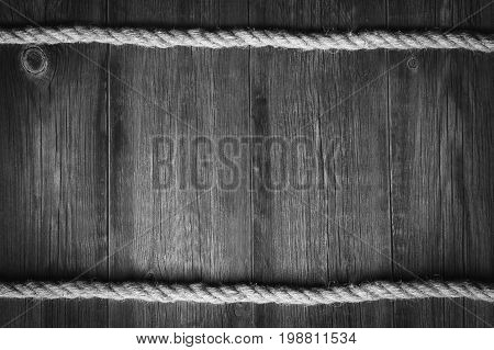 Wooden vintage background with a sea rope