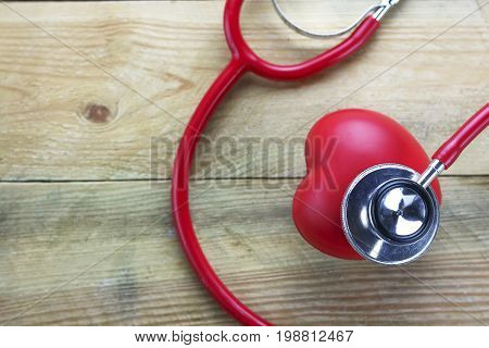 Healthy hearth concept ear doctor on wood background