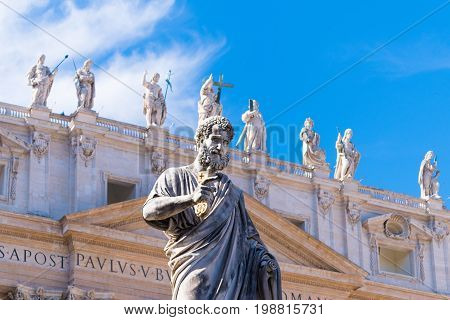 VATICAN CITY VATICAN - OCTOBER 16 2016: Statue Saint Peter in front of St Peter's Basilica on piazza San Pietro
