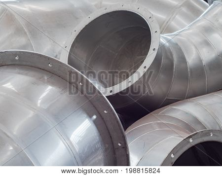 Stainless steel ducting parts for an industrial size ventilation system.