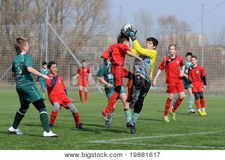 KAPOSVAR, HUNGARY - MARCH 21: Peter Ignac (in yellow) in action at the Hungarian National Championship under 13 game between Kaposvari Rakoczi FC and Pecsi MFC March 21, 2010 in Kaposvar, Hungary.