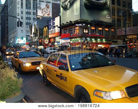 New York taxis at dusk. Nov 12th 2016. New York's cabs face uncertain future in wake of Uber and Lyft.