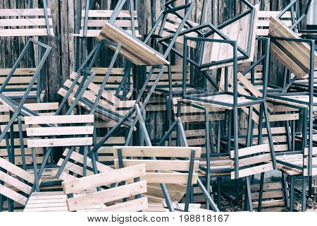 Wooden Chairs In Random Disarray