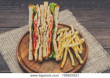Fast food meals at sandwich bar, french fries with chicken toast, takeaway composition