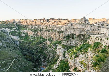 ancient ghost town of Matera (Sassi di Matera) reflect to the red sun rise southern Italy.