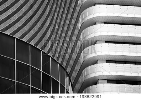 Modern buildings of glass and concrete. Abstract background. Black and white image. Horizontal