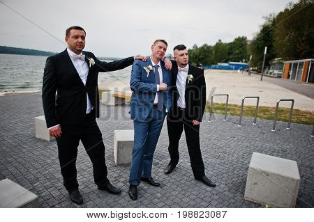 Groom With His Groomsmen Going Wild On His Wedding Day On The Lakeside.