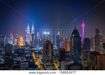 Cityscape of Kuala lumpur city skyline at night in Malaysia. Tilf shift effect photo