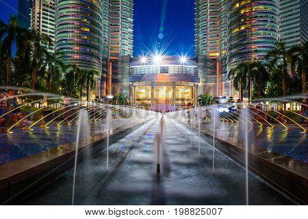 KUALA LUMPUR MALAYSIA - JULY 29 2017. Petronas Twin Towers at night on July 29 2017. The tallest buildings in the world from 1998 to 2004 and remain the tallest twin towers in the world. The buildings are a landmark of Kuala Lumpur