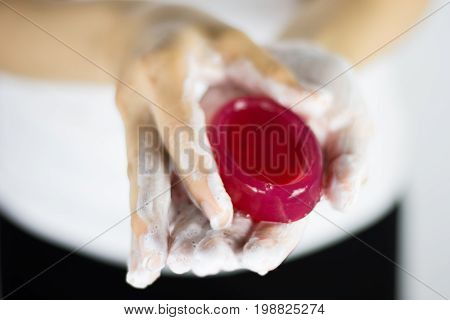 Washing of hands with soap under running water.Cleaning Hands.Asian young woman is washing hands with red soap