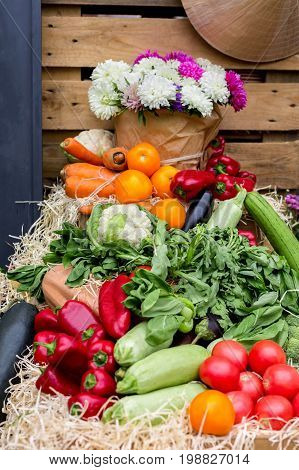 Autum harvest of vegetables. Organic farmers food market. Fresh products, vegetables and flowers on sale at the local market, close-up, selective focus