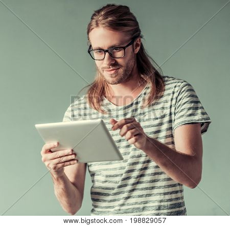 Young Man With Gadget
