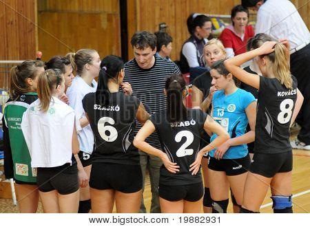 KAPOSVAR, HUNGARY - APRIL 13: Miskolc players listen to their trainer at the Hungarian NB I. League woman volleyball game Kaposvar vs Miskolc, April 13, 2010 in Kaposvar, Hungary.