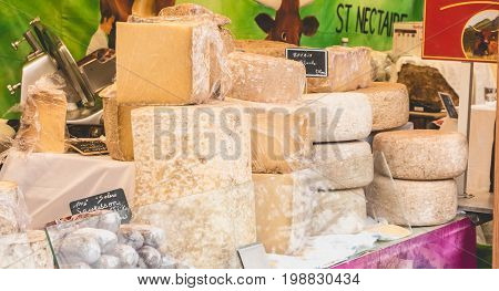 LA ROCHE-SUR-YON FRANCE - december 19 2016 : Display of French cheeses and sausages on a street market