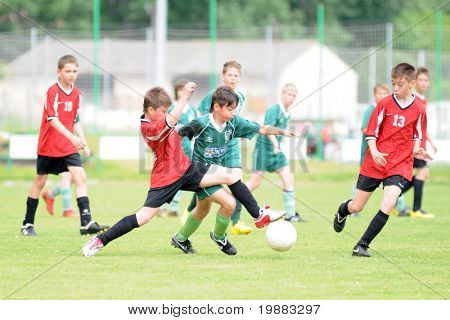 KAPOSVAR, HUNGARY - MAY 9: Barnabas Ozorai (in green C) in action at the Hungarian National Championship under 13 game between Kaposvari Rakoczi and Nagykanizsa May 9, 2010 in Kaposvar, Hungary.