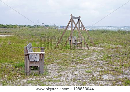 Two wooden benches at a beach on an overcast day, Florida, USA