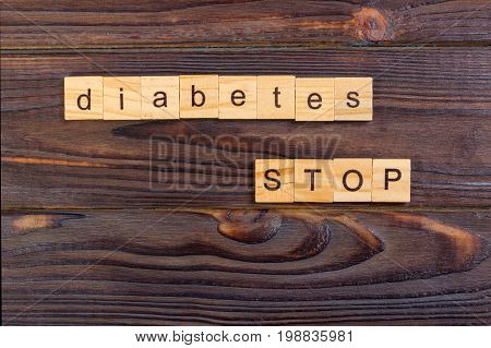 stop diabetes text word made with wood blocks. Concept Diabetes Prevention