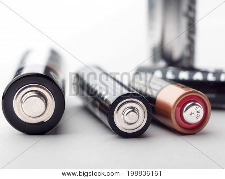 alkaline batteries with selective focus on white background. Close-up
