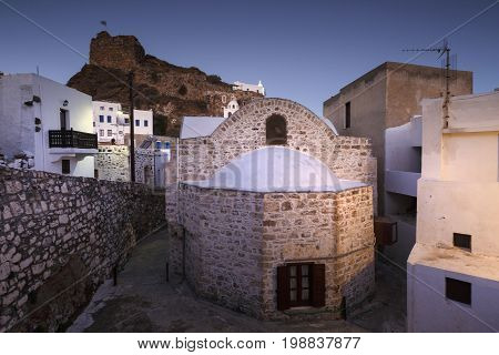 Early morning view of Mandraki village and the castle, Greece.