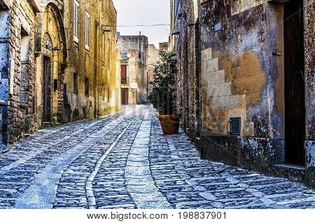 Drawing in cobblestones in the streets of the city of erice
