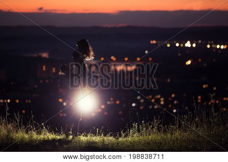 Lovers man and girl against dance background night city, night starry sky and horizon. Concept date Valentine's Day, first kiss love, forever together.