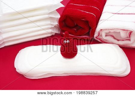 Dreamy smile crochet blood drop Terry bath towels daily and menstrual pads. Woman critical days gynecological menstruation cycle. Hygiene conception photo. Menstruation sanitary woman hygiene
