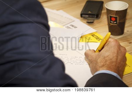 Dordrecht The Netherlands - December 10 2015: Man writing a letter during a letter-writing campaign organised in Dordrecht library by Amnesty International.