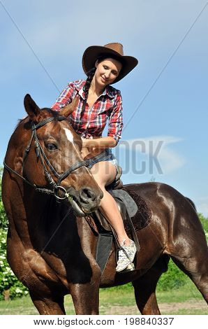 young cowgirl horseback riding in sunny dayvertical composition