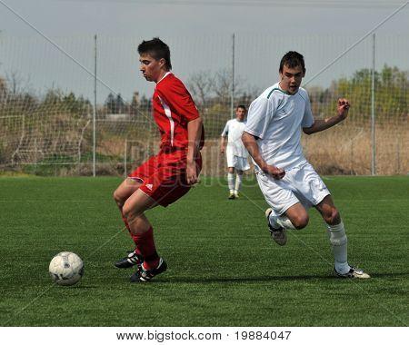 KAPOSVAR, HUNGARY - APRIL 10: Krisztian Kirchner (R) in action at the Hungarian National Championship under 17 game between Rakoczi FC and Debrecen April 10, 2010 in Kaposvar, Hungary.