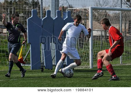 KAPOSVAR, HUNGARY - APRIL 10: Krisztian Kirchner (C) in action at the Hungarian National Championship under 17 game between Rakoczi FC and Debrecen April 10, 2010 in Kaposvar, Hungary.