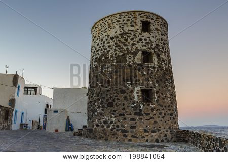 Old traditional windmill in Mandraki village on Nisyros island in Dodecanese island group, Greece.