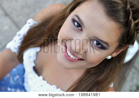 close-up portrait of young stylish woman looking at camera