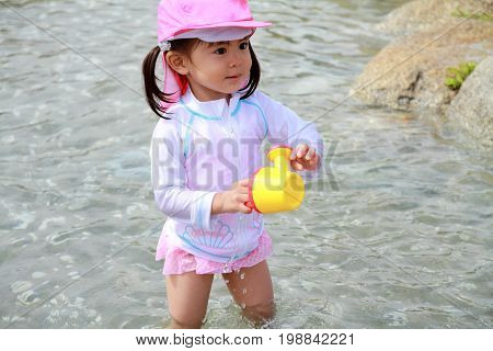 Japanese Girl Playing With Water With Watering Pot (2 Years Old)
