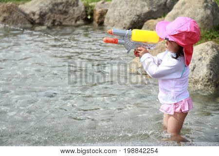 Japanese Boy Playing With Water Gun (2 Years Old)