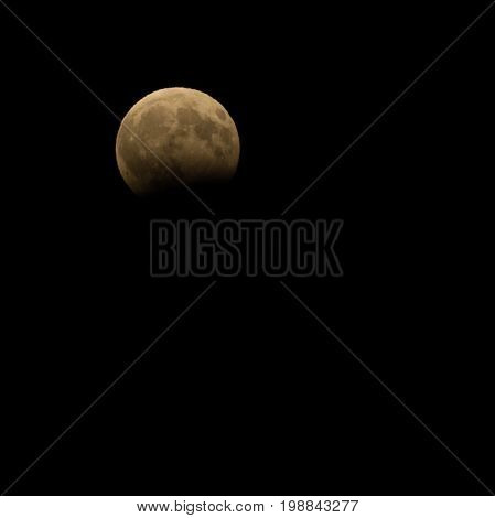 Partial eclipse of the full moon on the night sky