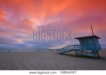 Lifeguard tower with the rosy afterglow of a sunset at Hermosa Beach California