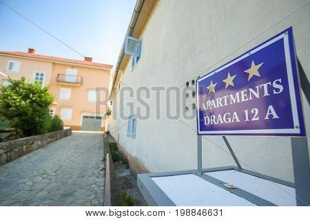 NJIVICE CROATIA - JUNE 24 2017 : Apartment rental sign in front of house in Njivice Krk Croatia.