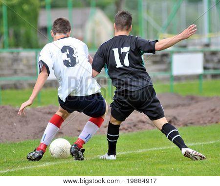 KAPOSVAR, HUNGARY - MAY 29: Bence Balogh (R) in action at the Hungarian National Championship under 19 game between Kaposvari Rakoczi and Barcsi FC May 29, 2010 in Kaposvar, Hungary.