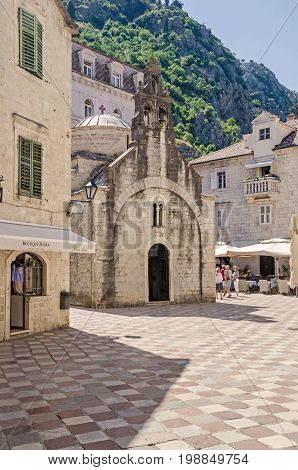 Kotor Montenegro - June 8 2017: Saint Luke square with the St. Luka's one-nave church built by Mauro Kacafrangi in 1195 example of the Romanesque and Byzantine architecture in the old town of Kotor. It is a part of UNESCO's World Heritage Site.