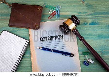 Corruption concept. Notebook on a bright green background. Office stationery accessories.