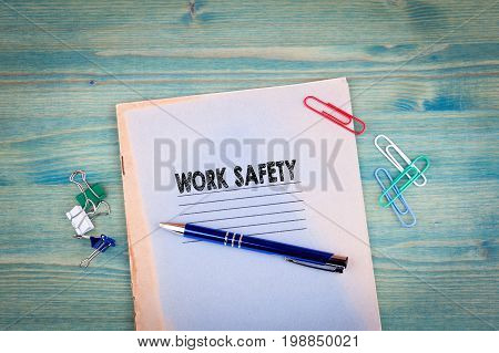 work safety concept. Notebook on a bright green background. Office stationery accessories.