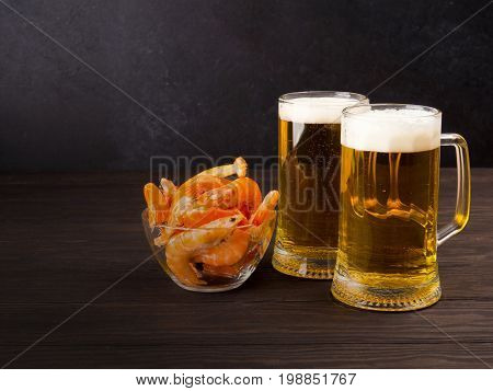 There Are Two Glasses Of Light Beer On Black Background, With Shrimp, Space For Text