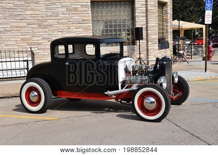 CASSELTON, NORTH DAKOTA, July 27, 2017: The annual Casselton Car Show which occurs the last Thursday of July features classic vehicles such as the restored 1931Black Street Rod Model A Ford