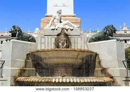 MADRID, SPAIN - MAY 24, 2017:This is an architectural fragment of the fountain at the pedestal of the monument to Philip IV on the square of Oriente.