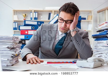 Businessman busy with much paperwork