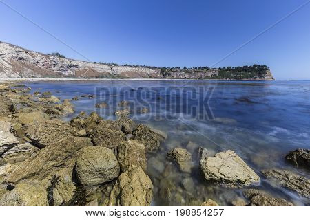 Lunada Bay with motion blur waves in the Palos Verdes Estates area of Los Angeles County, California.