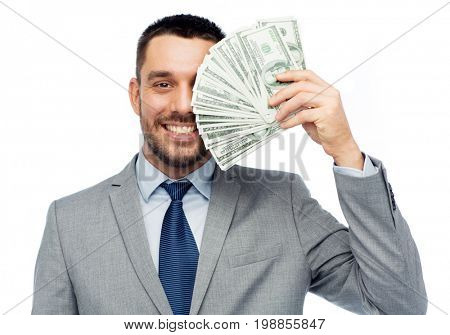 business, people and finances concept - smiling businessman with bundle of american dollar cash money
