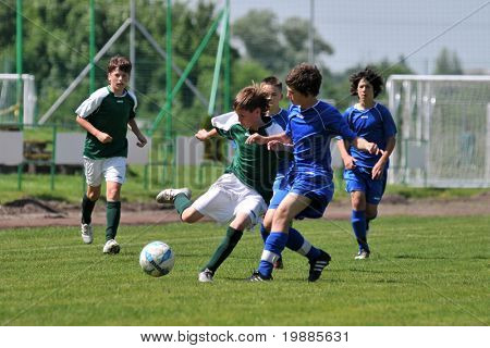 KAPOSVAR, HUNGARY - JUNE 12: Armin Prukner (2nd from L) in action at the Hungarian National Championship under 13 game between Kaposvari Rakoczi and Tatabanya June 12, 2010 in Kaposvar, Hungary.
