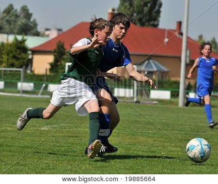 KAPOSVAR, HUNGARY - JUNE 12: Armin Prukner (L) in action at the Hungarian National Championship under 13 game between Kaposvari Rakoczi and Tatabanya June 12, 2010 in Kaposvar, Hungary.